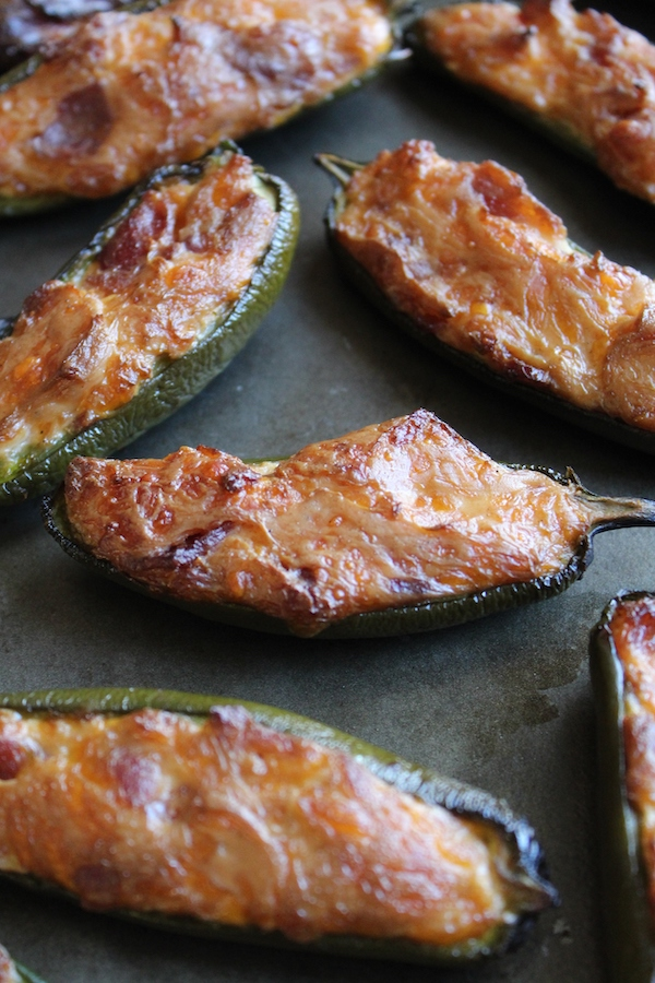 several smoked jalapeno poppers on pan